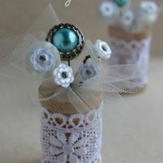 Vintage button flower and thread spool arrangement