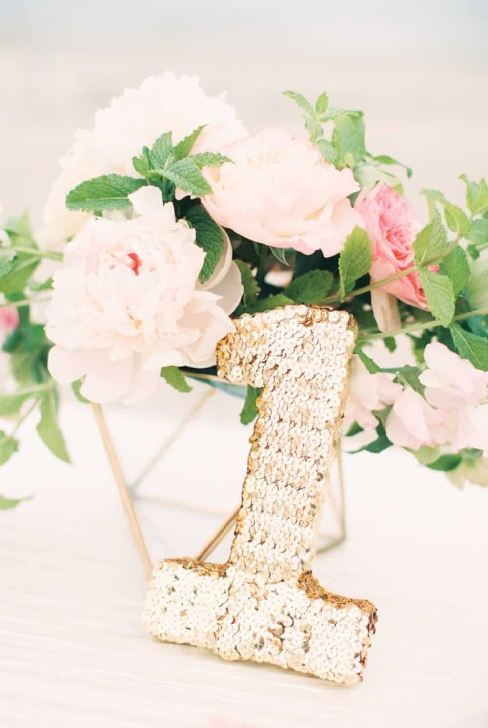 Diy sequins table number centerpieces
