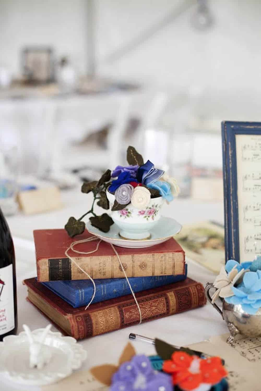 Diy teacup and books wedding centerpieces