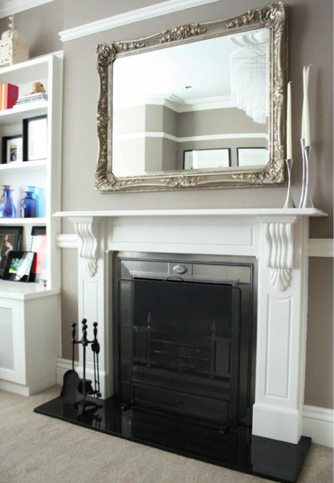 Fireplace mantel with a mirror