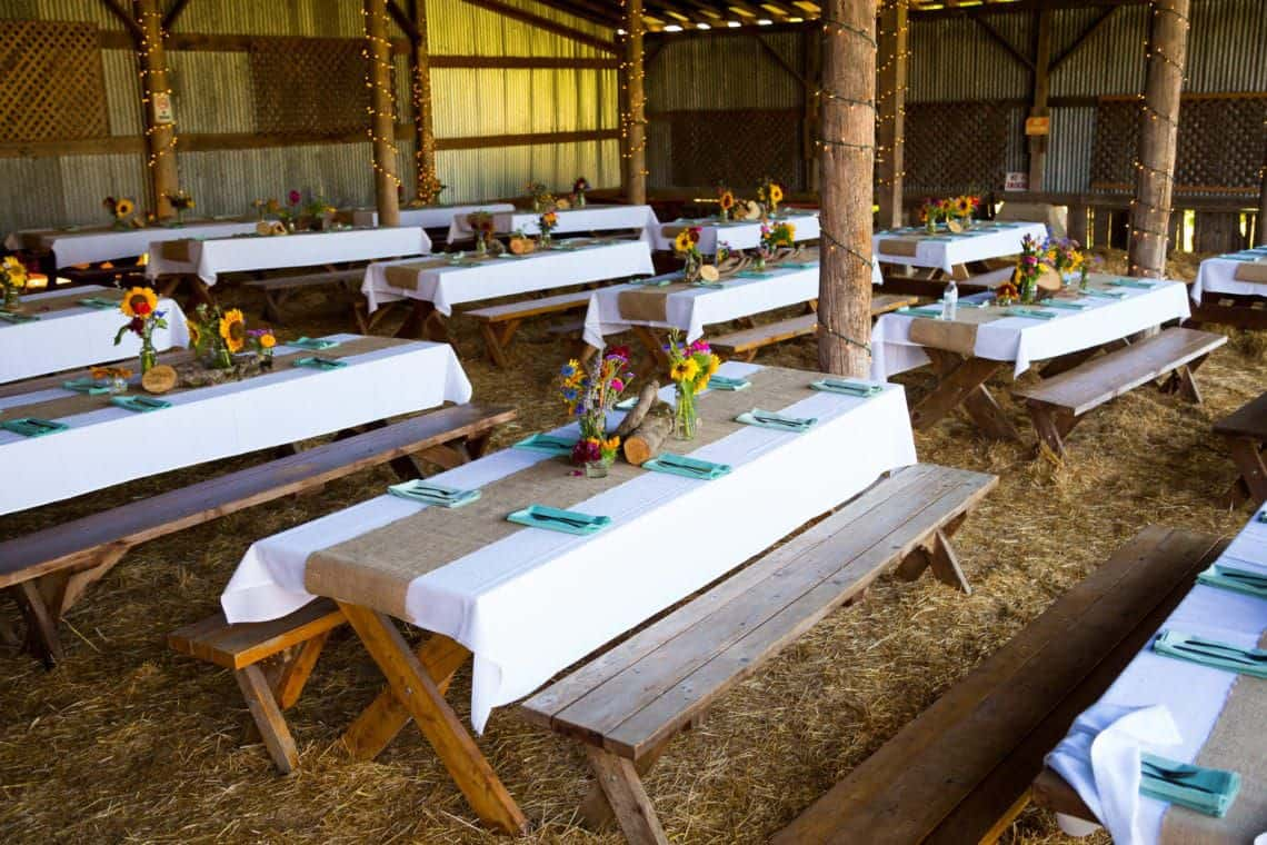 Picnic tables for a barn wedding