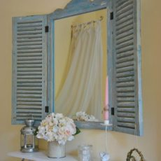 Bathroom mirror with vintage shutters