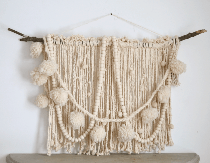 Chunky yarn, pom poms, and wooden beads branch hanging