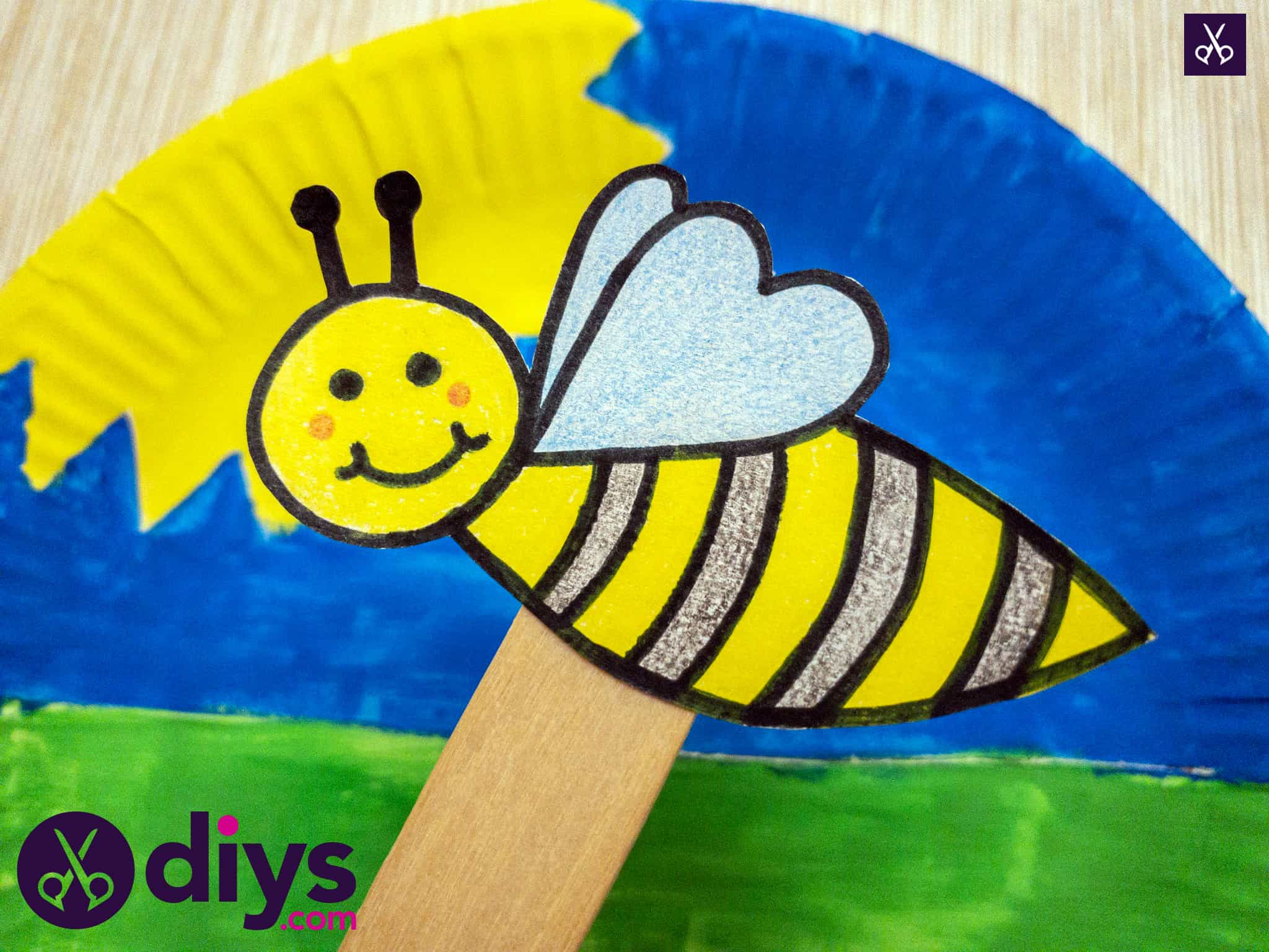 Colorful paper plate bee puppet