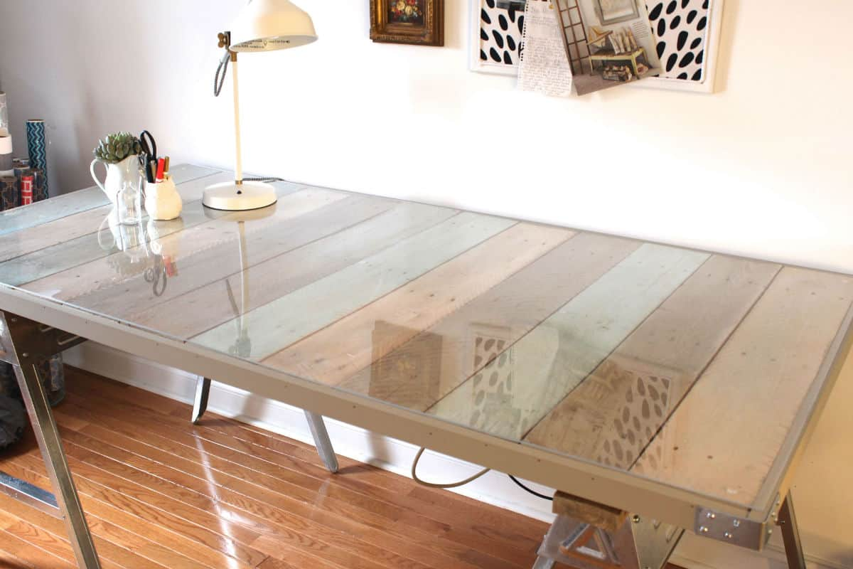 Glass top covered pallet wood desk