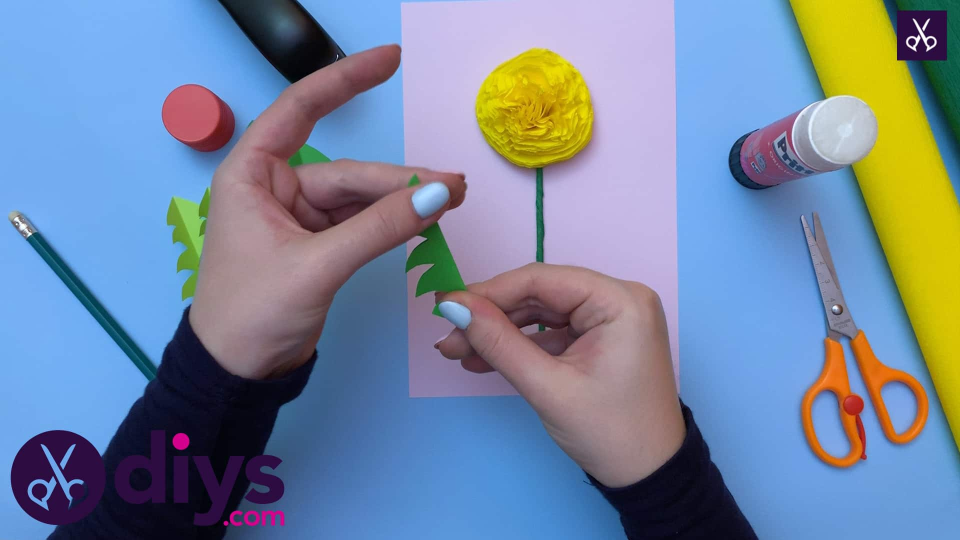 How to make a crepe paper flower glue all pieces