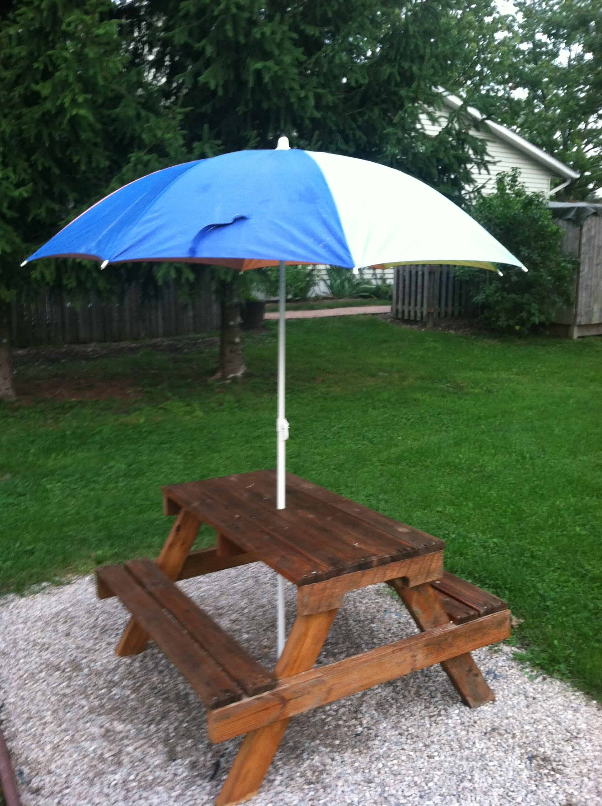 Kids' picnic table with an umbrella hole