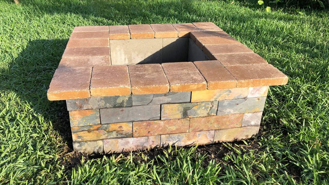 Multi coloured square cinder block fire pit
