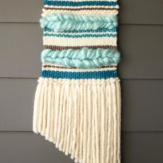 Mutli coloured woven wall hanging with chunky braidsa