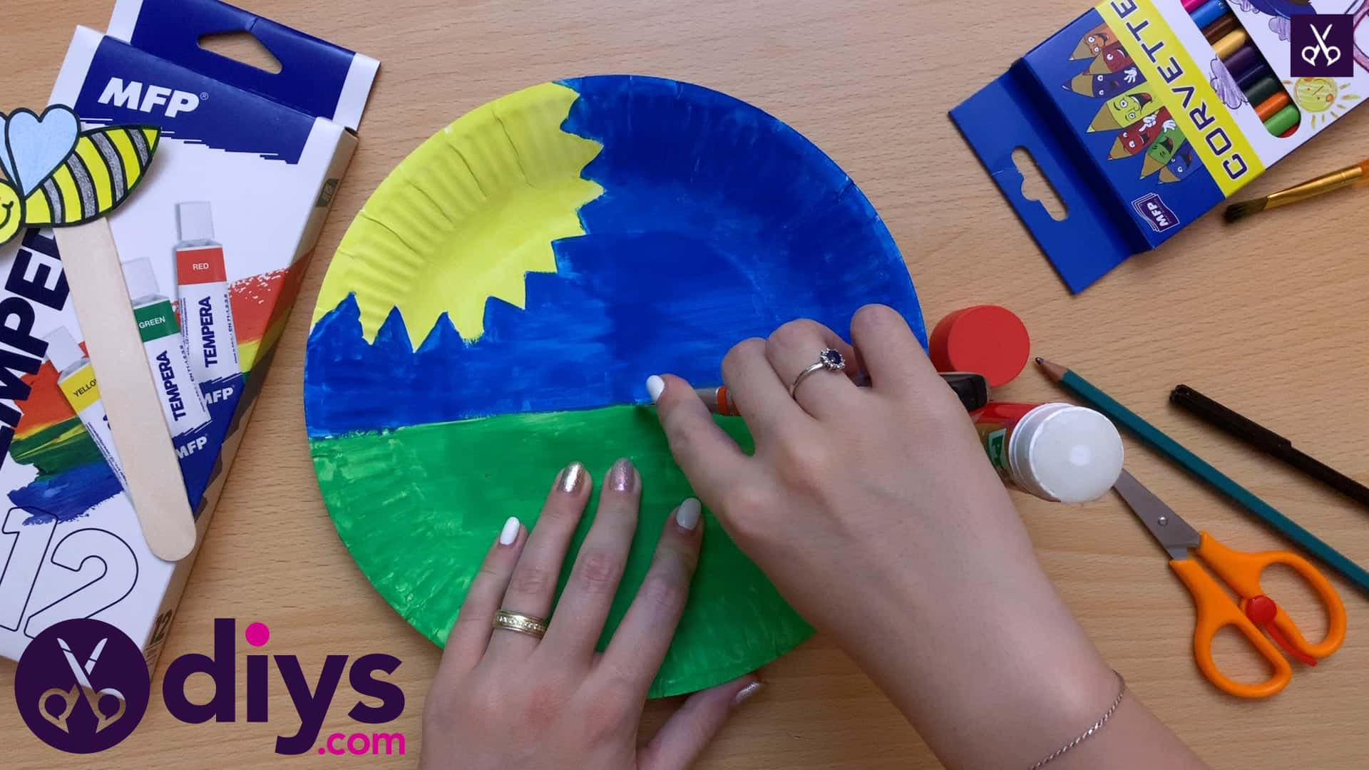 Paper plate bee puppet glue