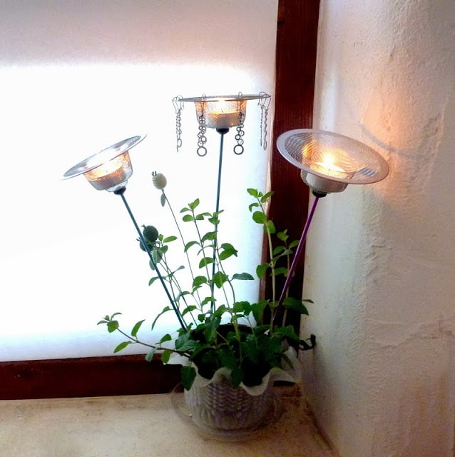 Planter tea lights from drain nets