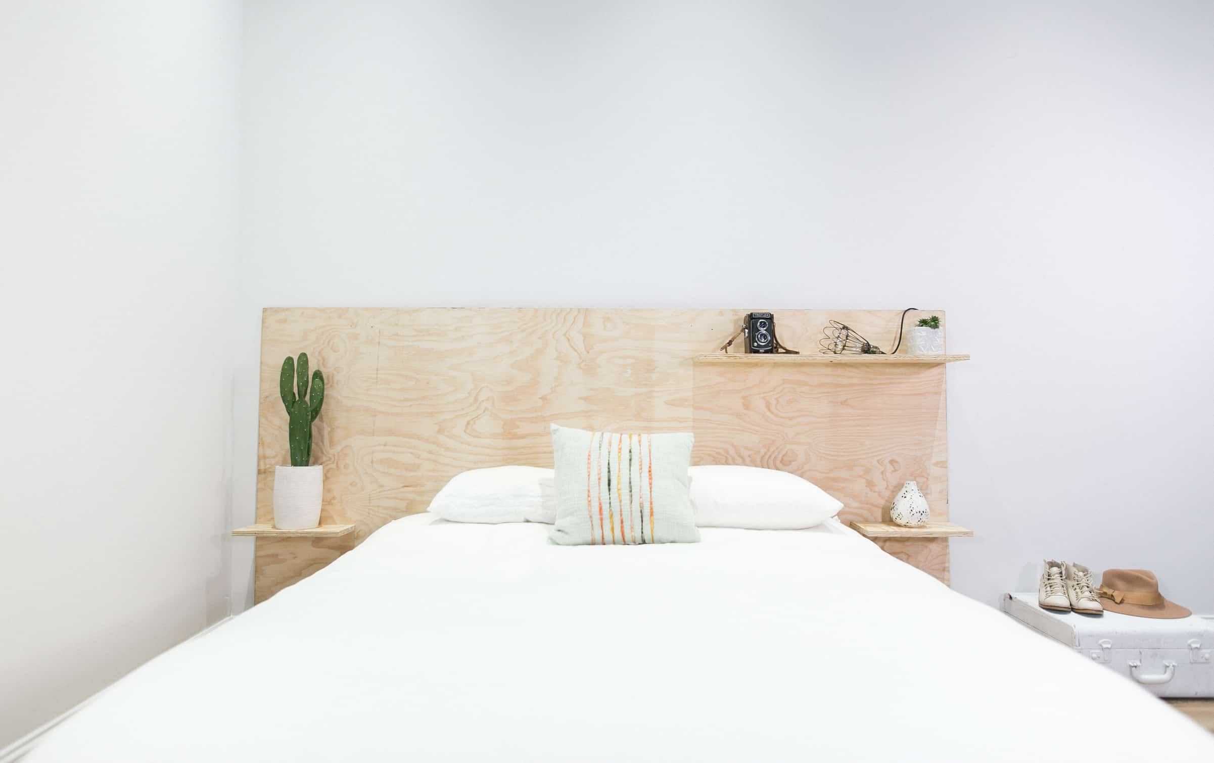 Plywood headboard with shelves
