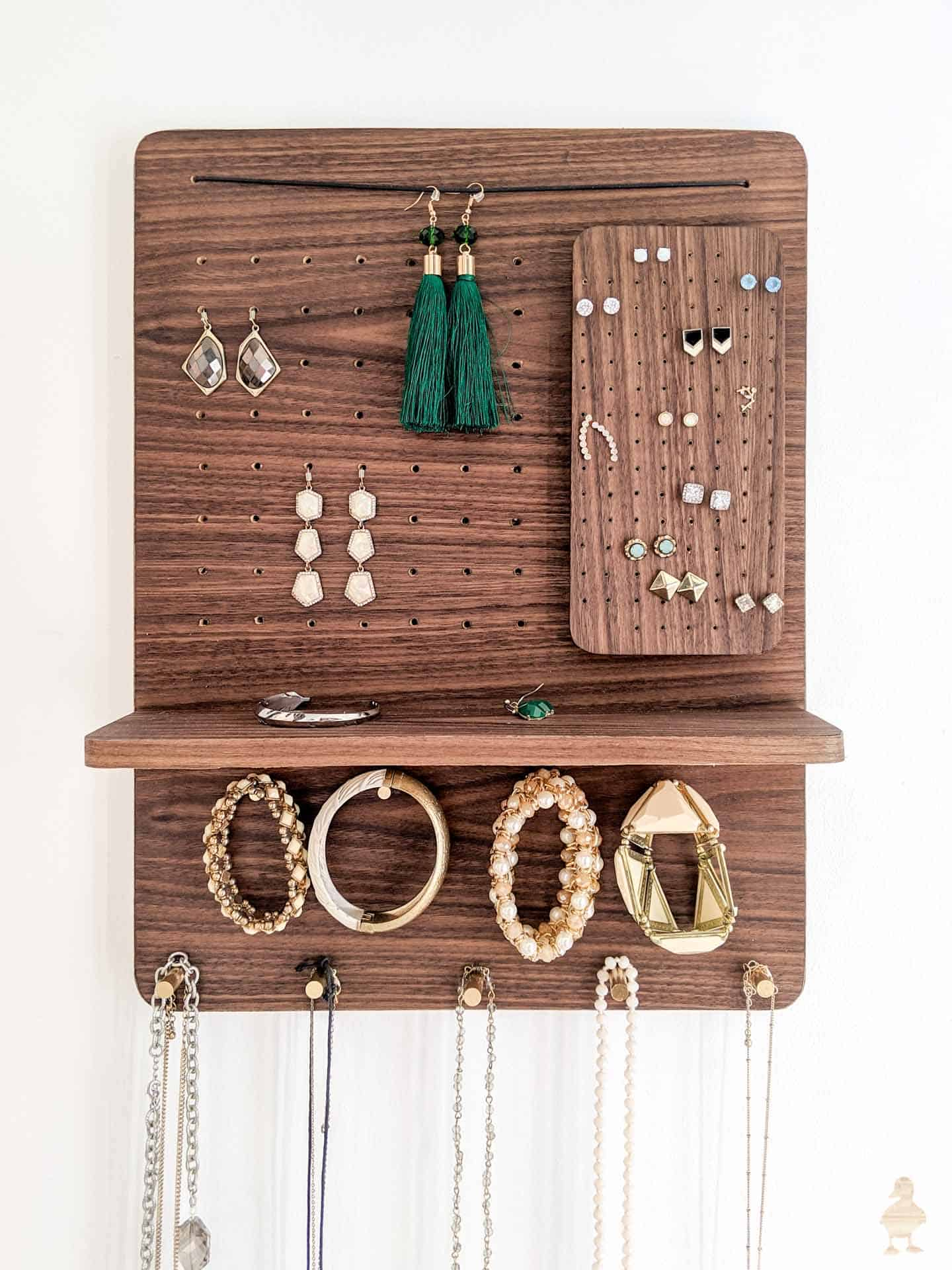 Wall mounted wooden peg, shelf, and holes organizer