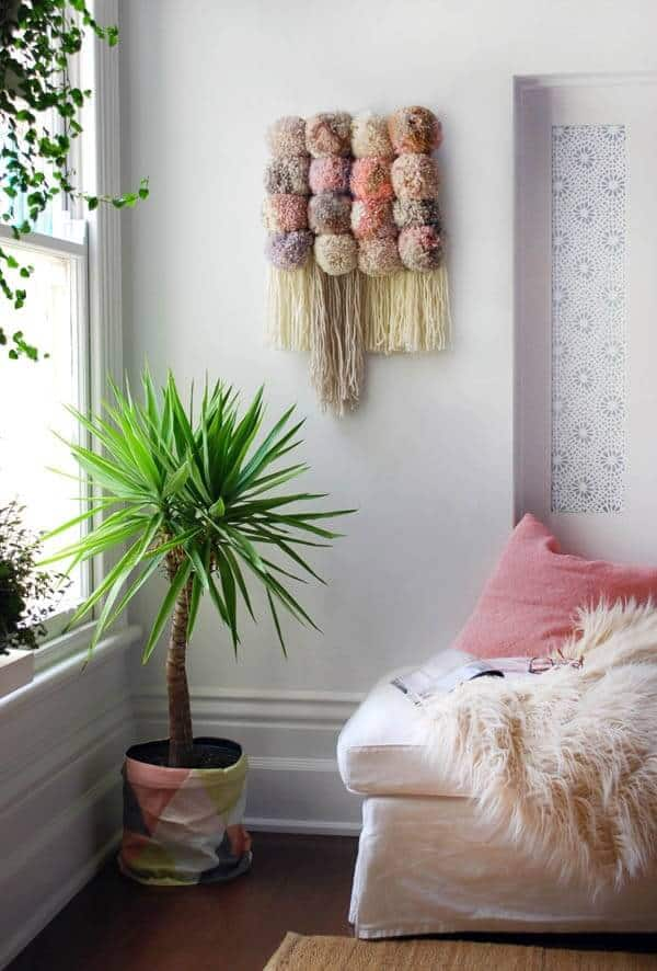 Diy puff and tassel wall hanging