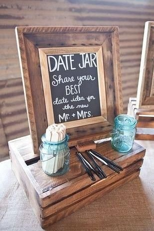 Date suggestion game using popsicle sticks and a chalkboard in a frame