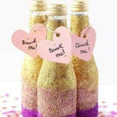 Glittered mini champagne bottles