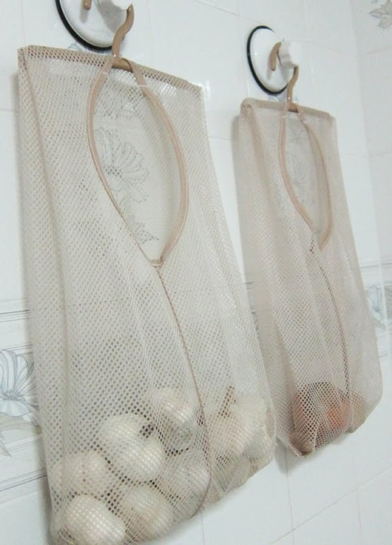 Mesh laundry bags to hang veggies