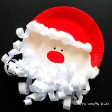 Curly bearded paper plate santa