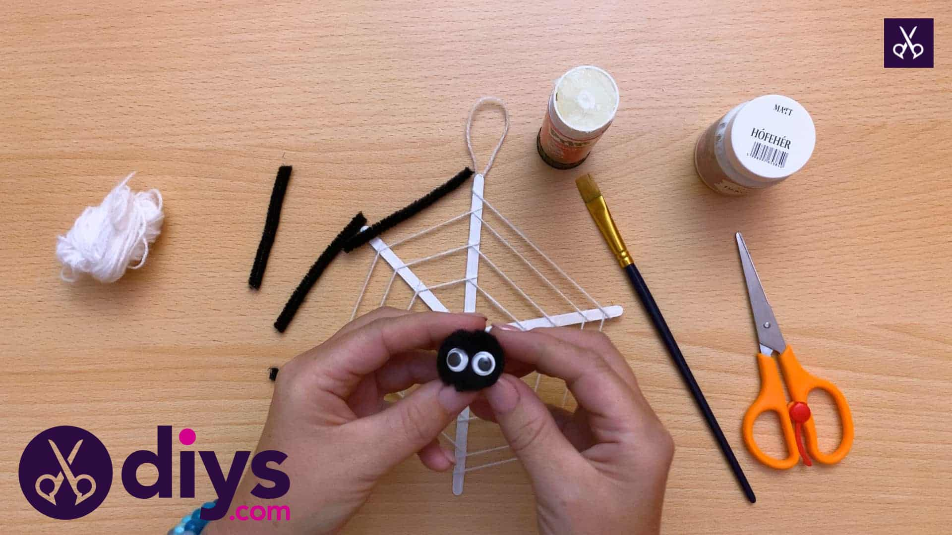 Diy spider web decoration for halloween pompo