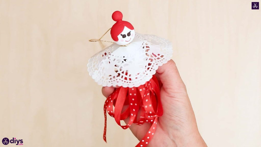 Doll ornament with bell