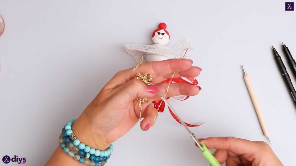 Doll ornament with bell step 9