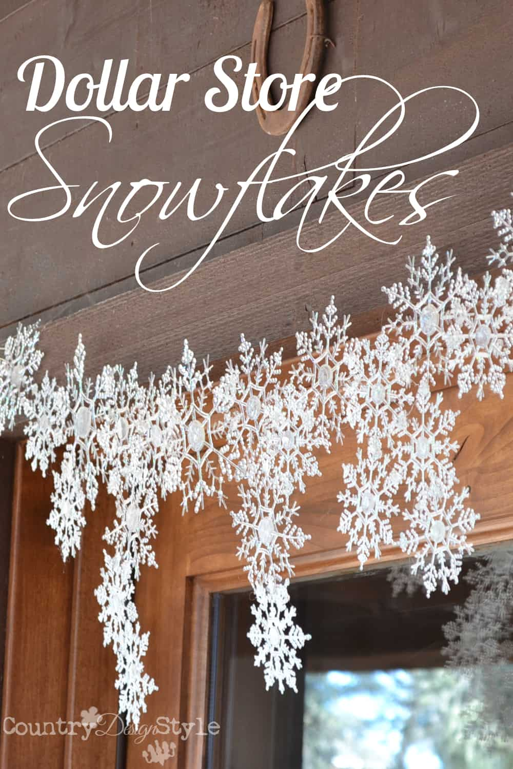 Hot glue and glitter dollar store snowflakes