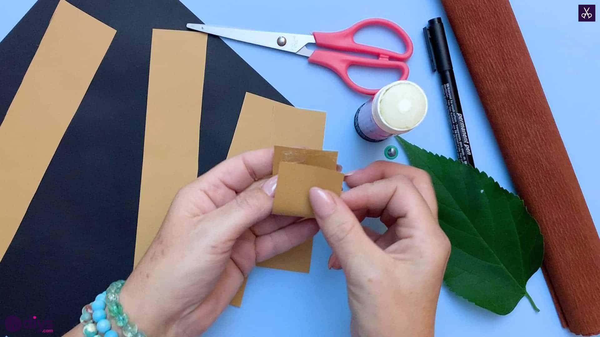 How to make a paper hedgehog on a fall leaf glue on top
