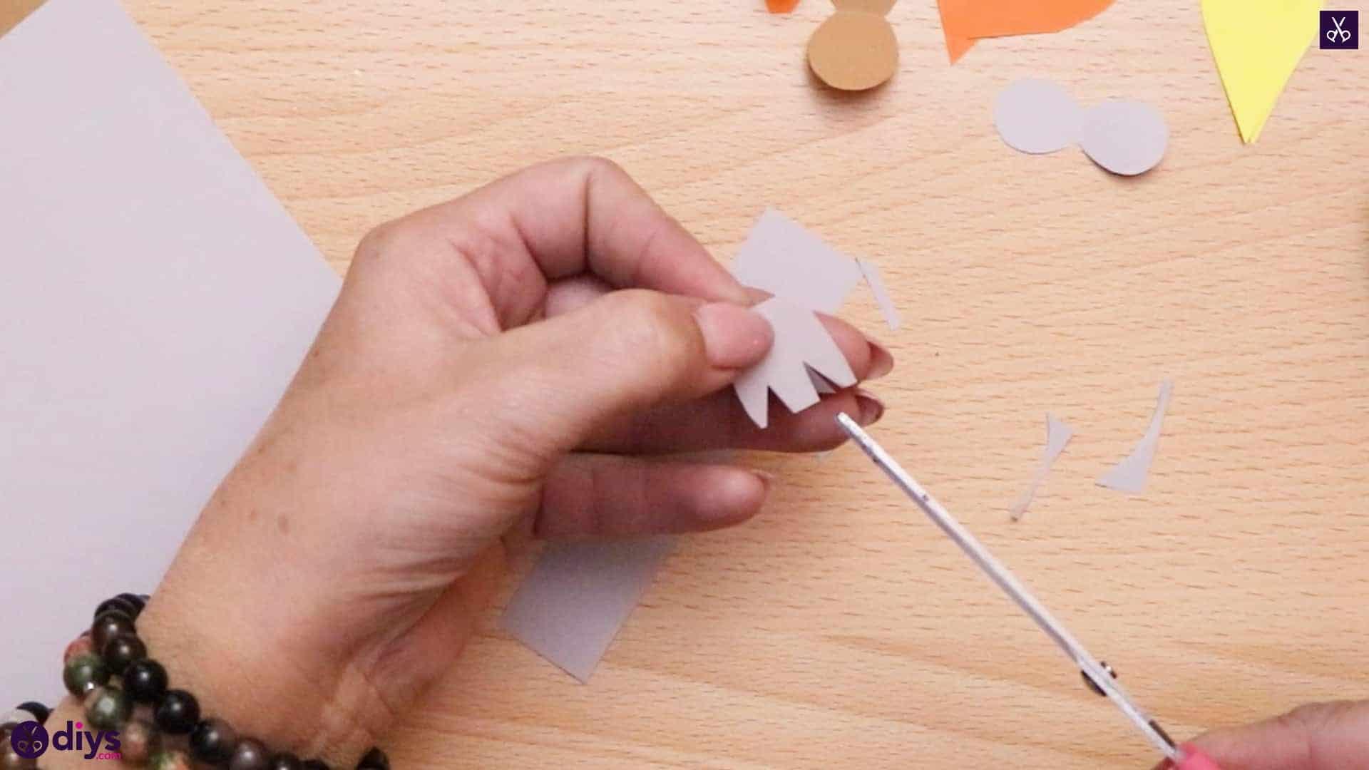 How to make a pinecone owl step 7