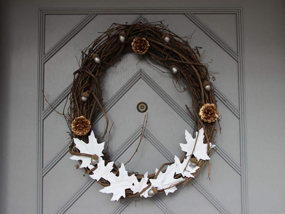 Metallic acorns and pinecones with white leaves wreath