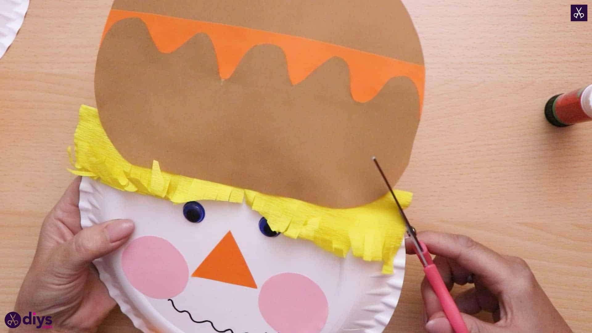 Paper plate scarecrow cut 1