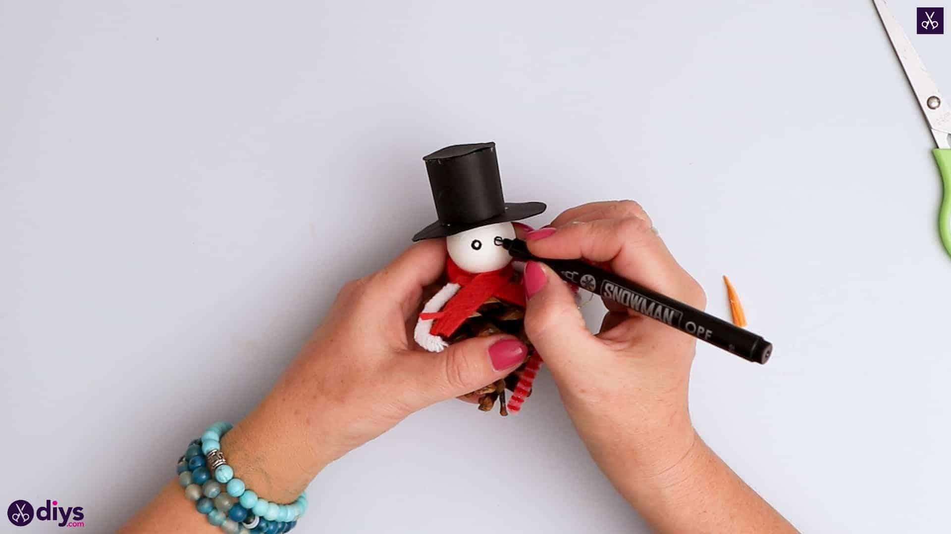 Pinecone snowman draw eye