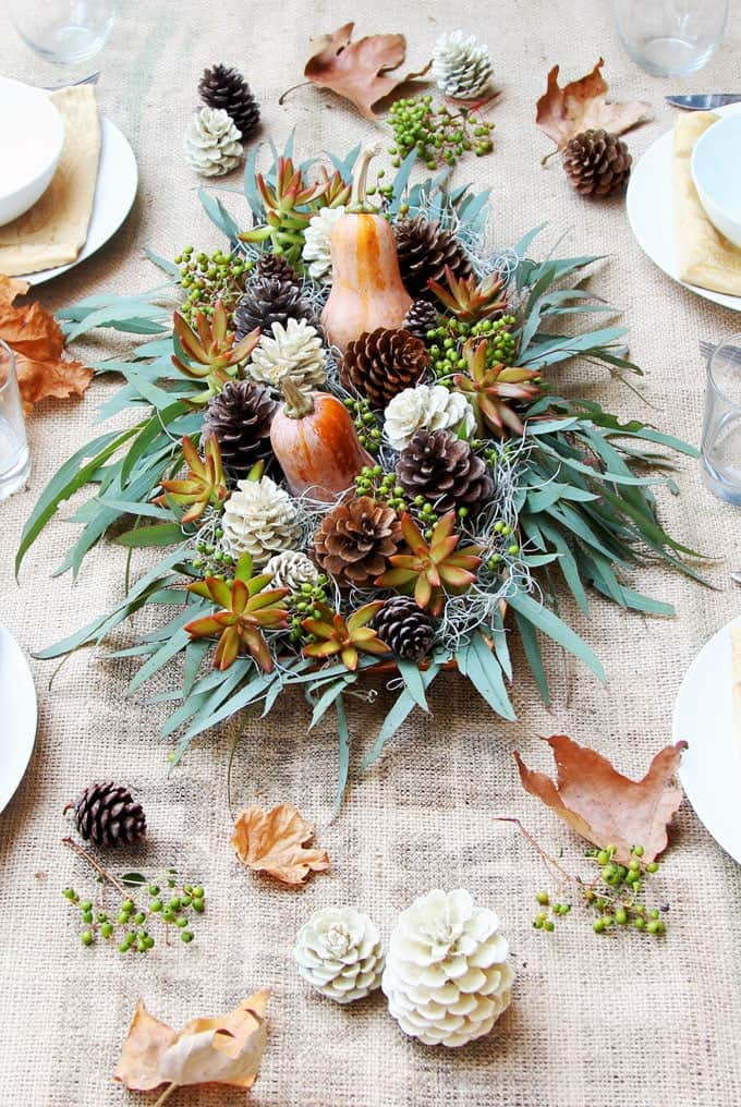 Pinecone, gourd, and grass filled tray