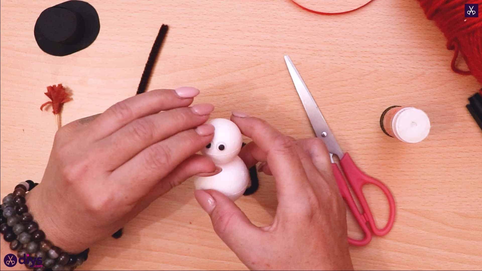 Styrofoam snowman apply glue