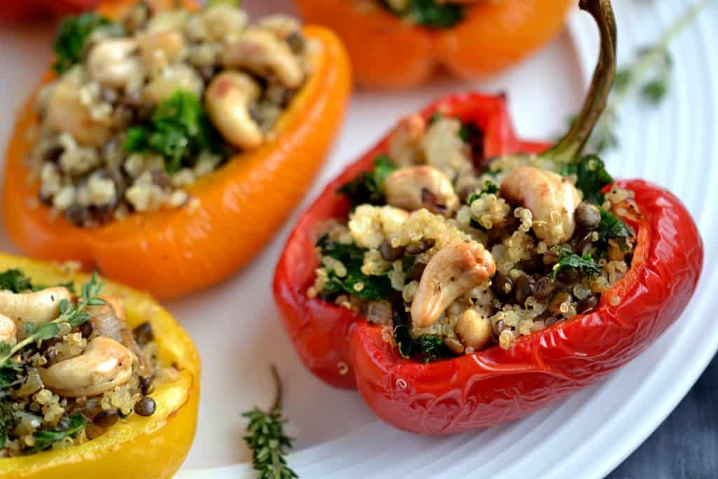 Vegan lentil, cashew, and quinoa stuffed peppers