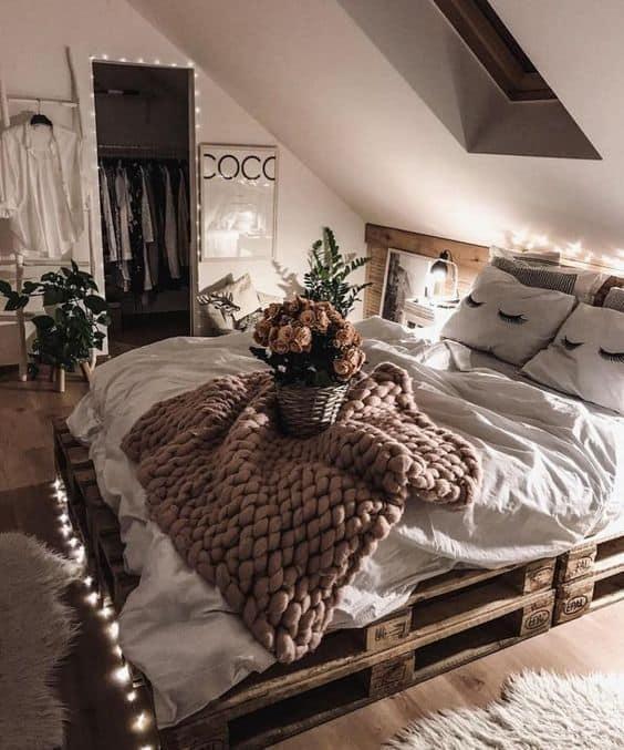 Outline bedroom furniture in string lights