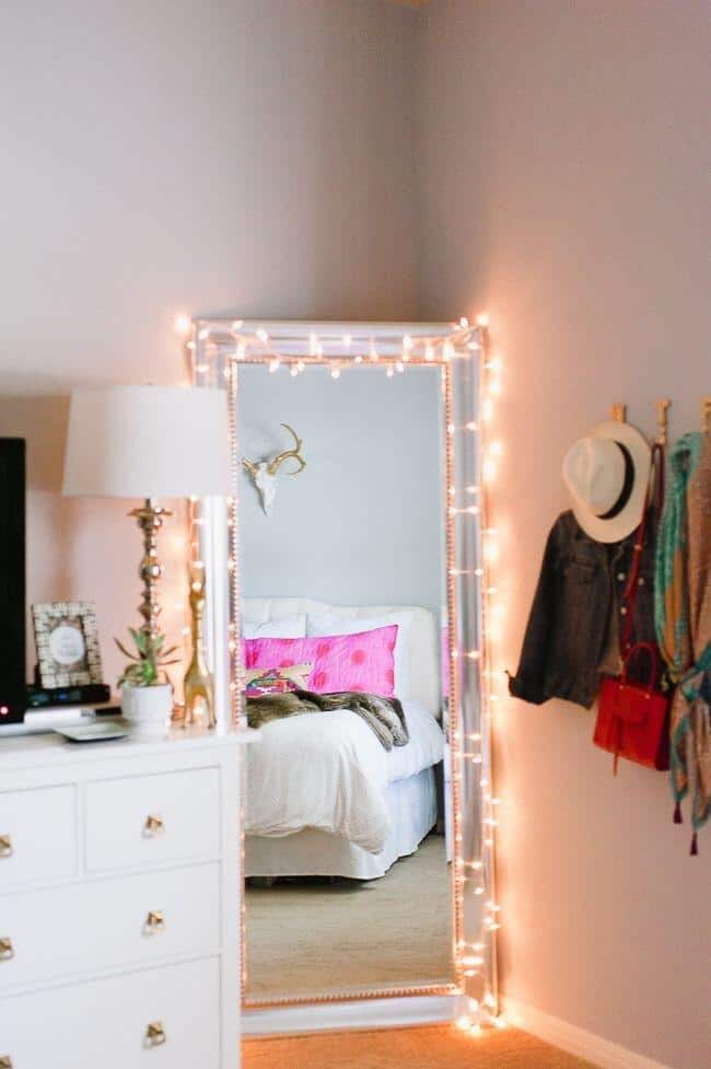 String lights over standing mirrors