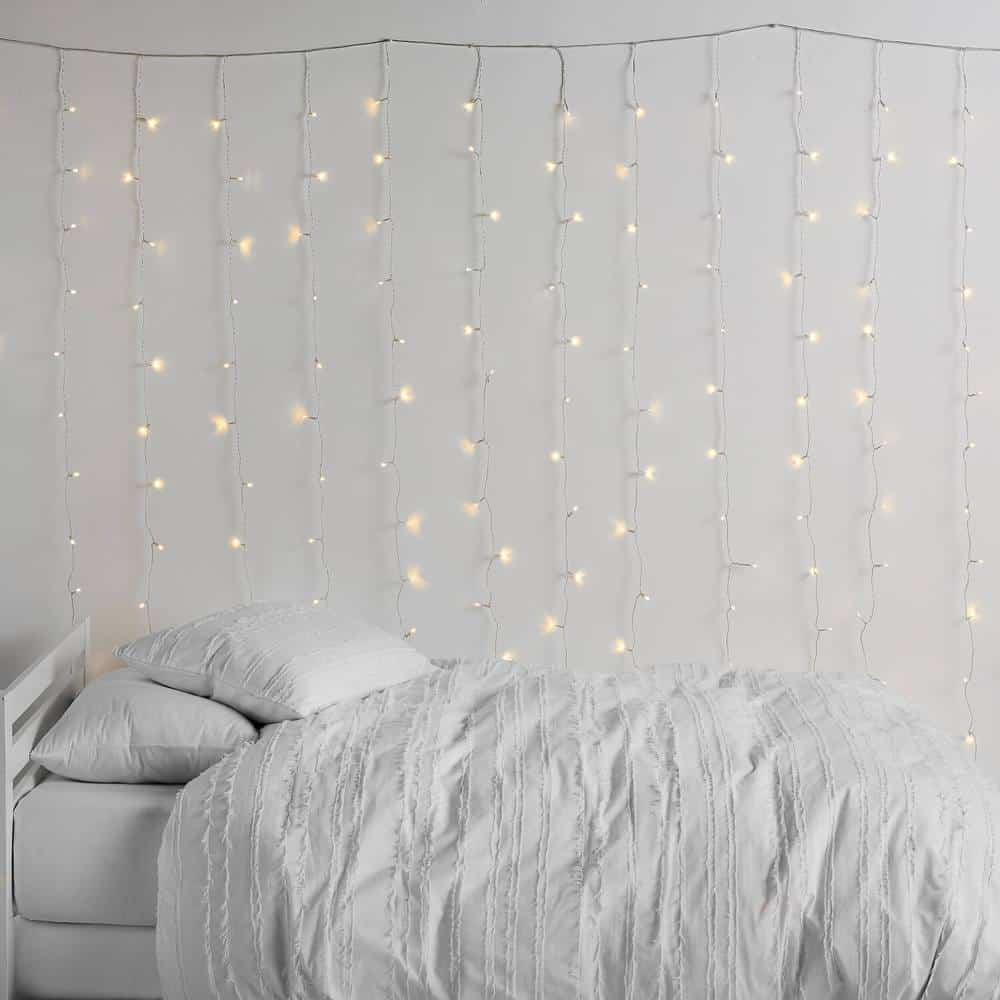 Tapestry string lights in bedroom