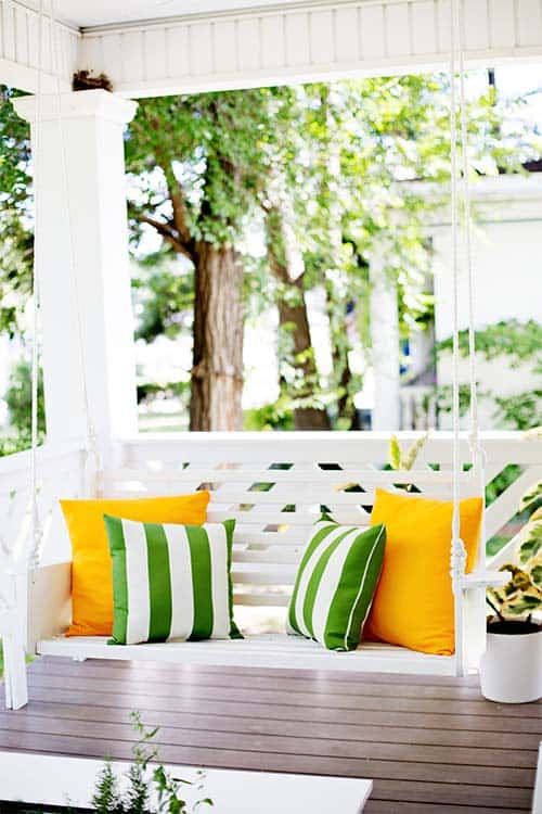 Classic white wooden porch swing