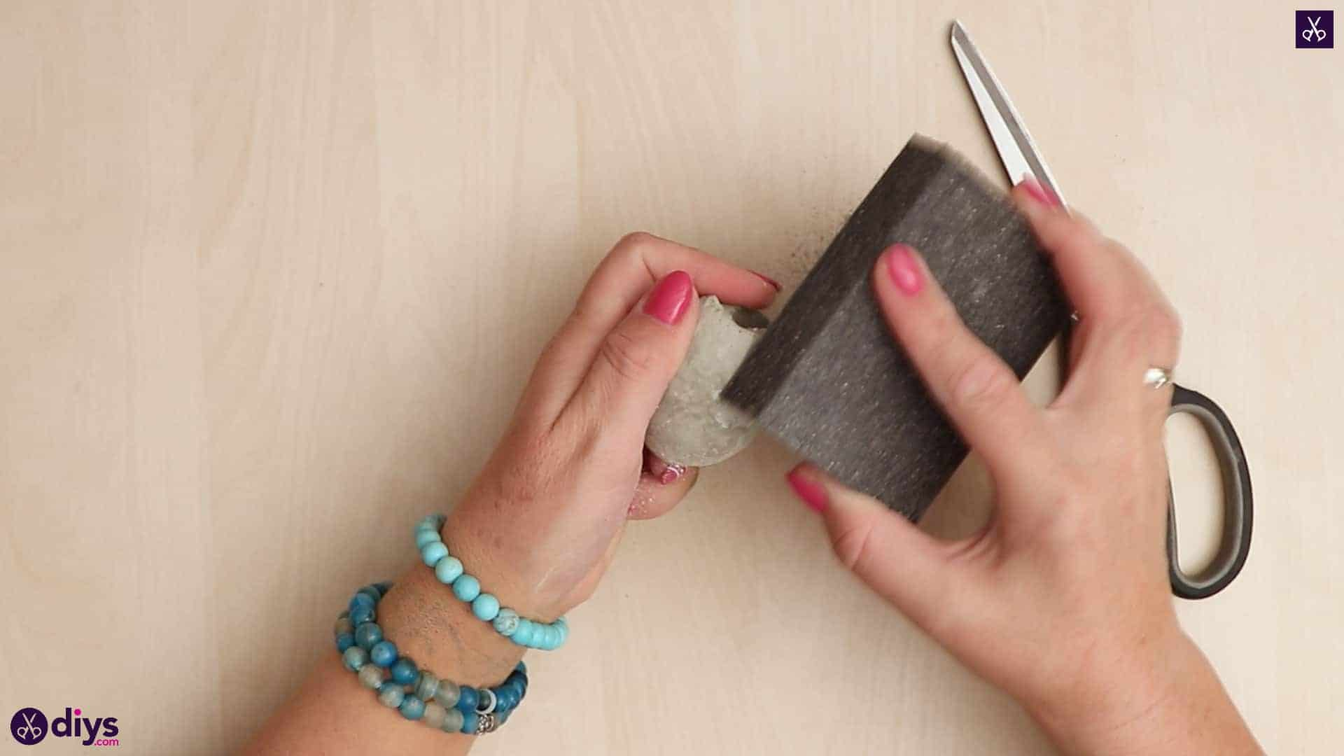 Concrete egg decoration sandpaper