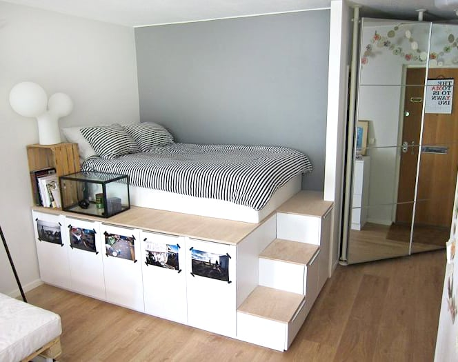 Custom storage platform bed with high cupboards and small steps