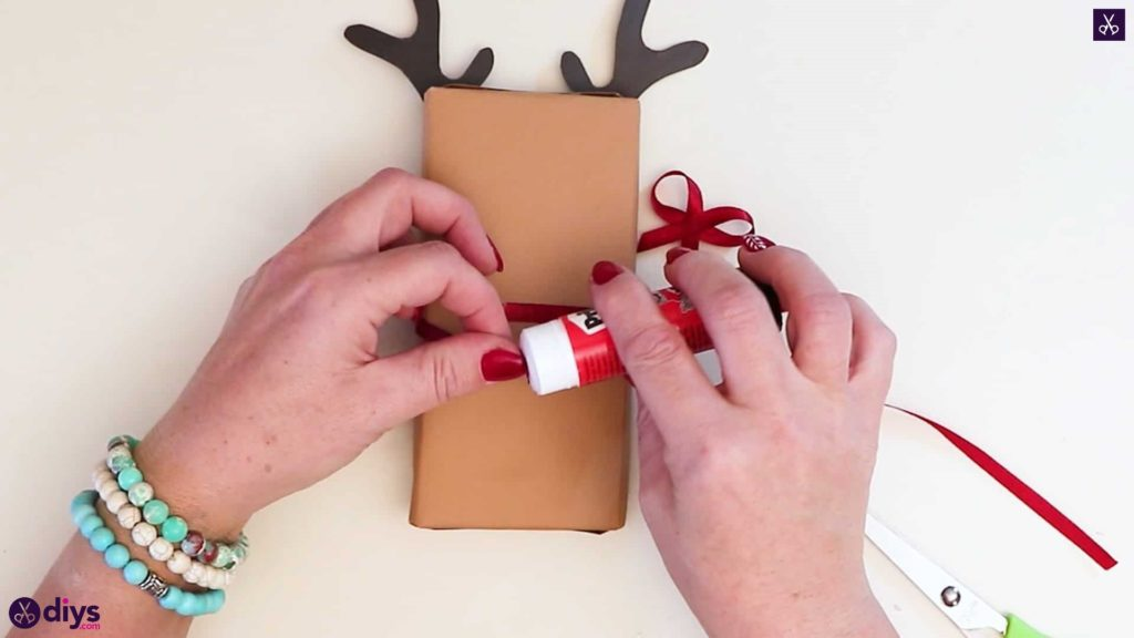 Diy reindeer gift wrap for christmas apply adhesive