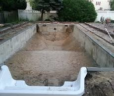 Full in ground pool with a hot tub at one end