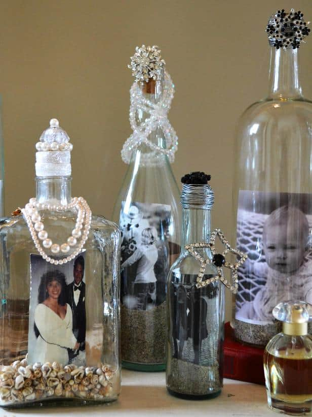 Old jewelry embellished wine bottle photo display