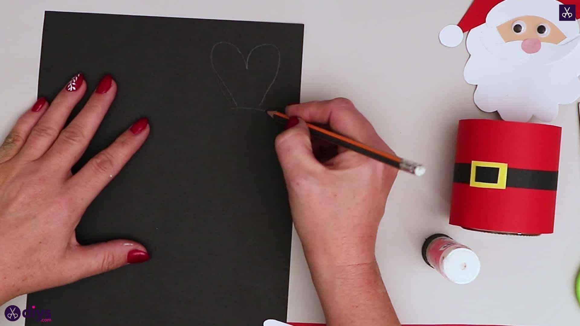 Paper santa candy holder draw black paper