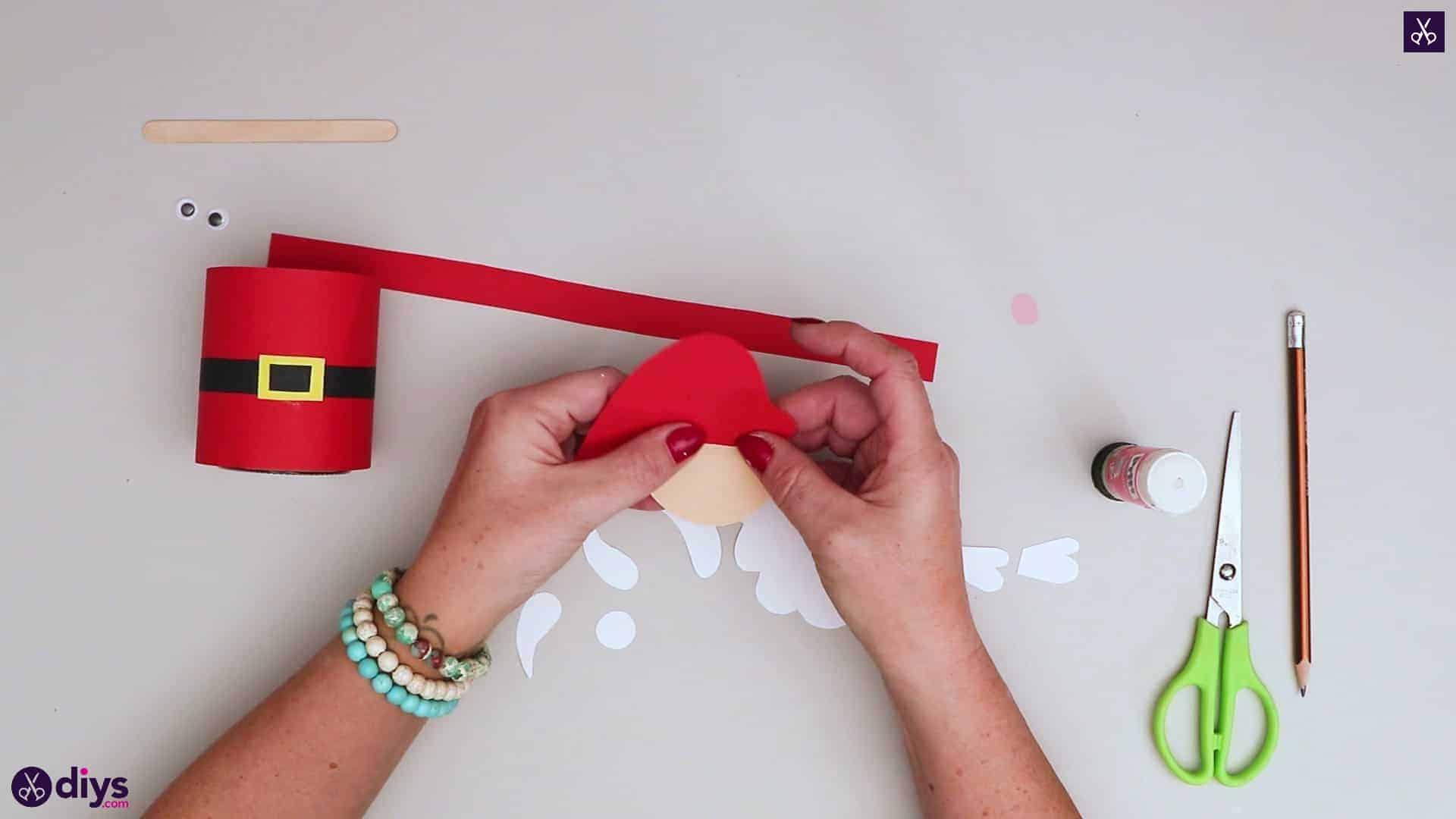 Paper santa candy holder press
