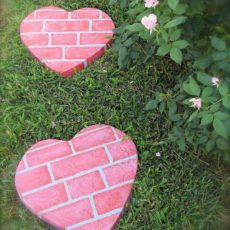 Pink brick painted concrete heart stepping stonesa