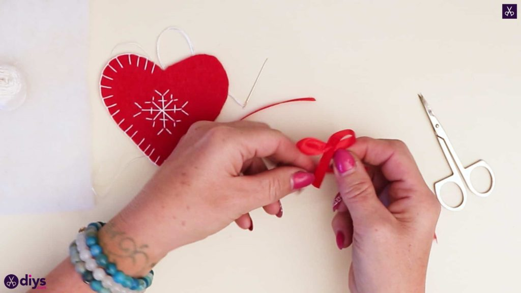 Snowflake embroidered heart ornament bow