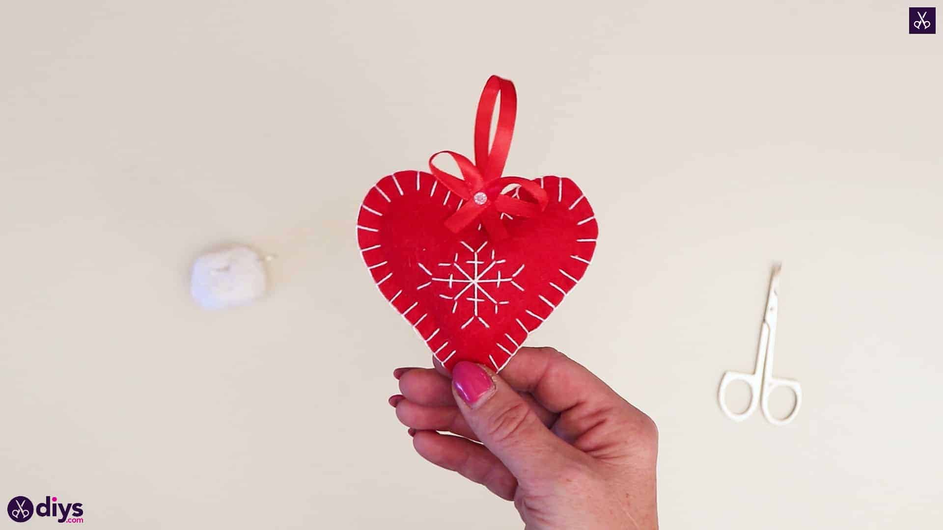 Snowflake embroidered heart ornament