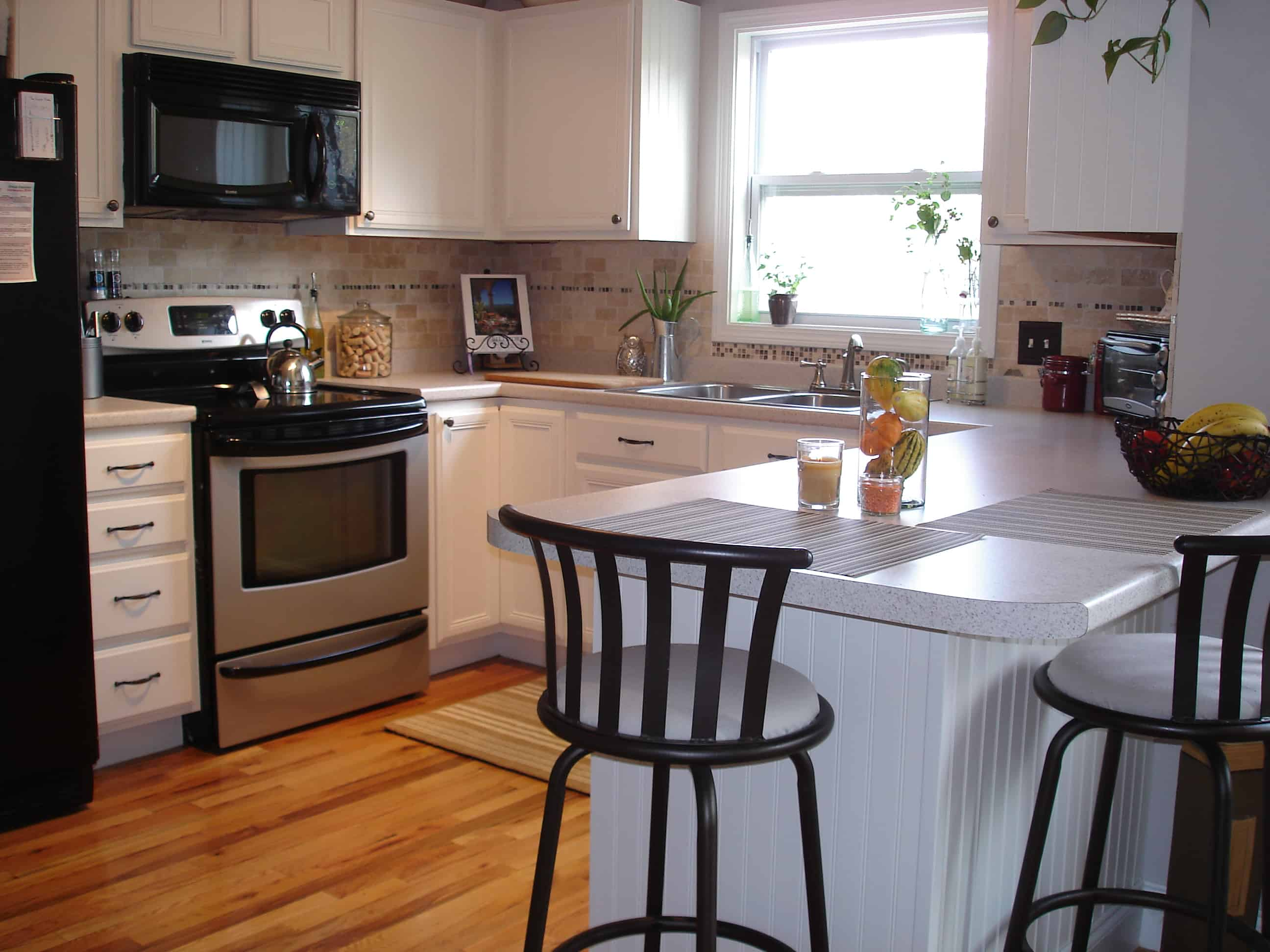 Tips for painting faux wood kitchen cabinets white