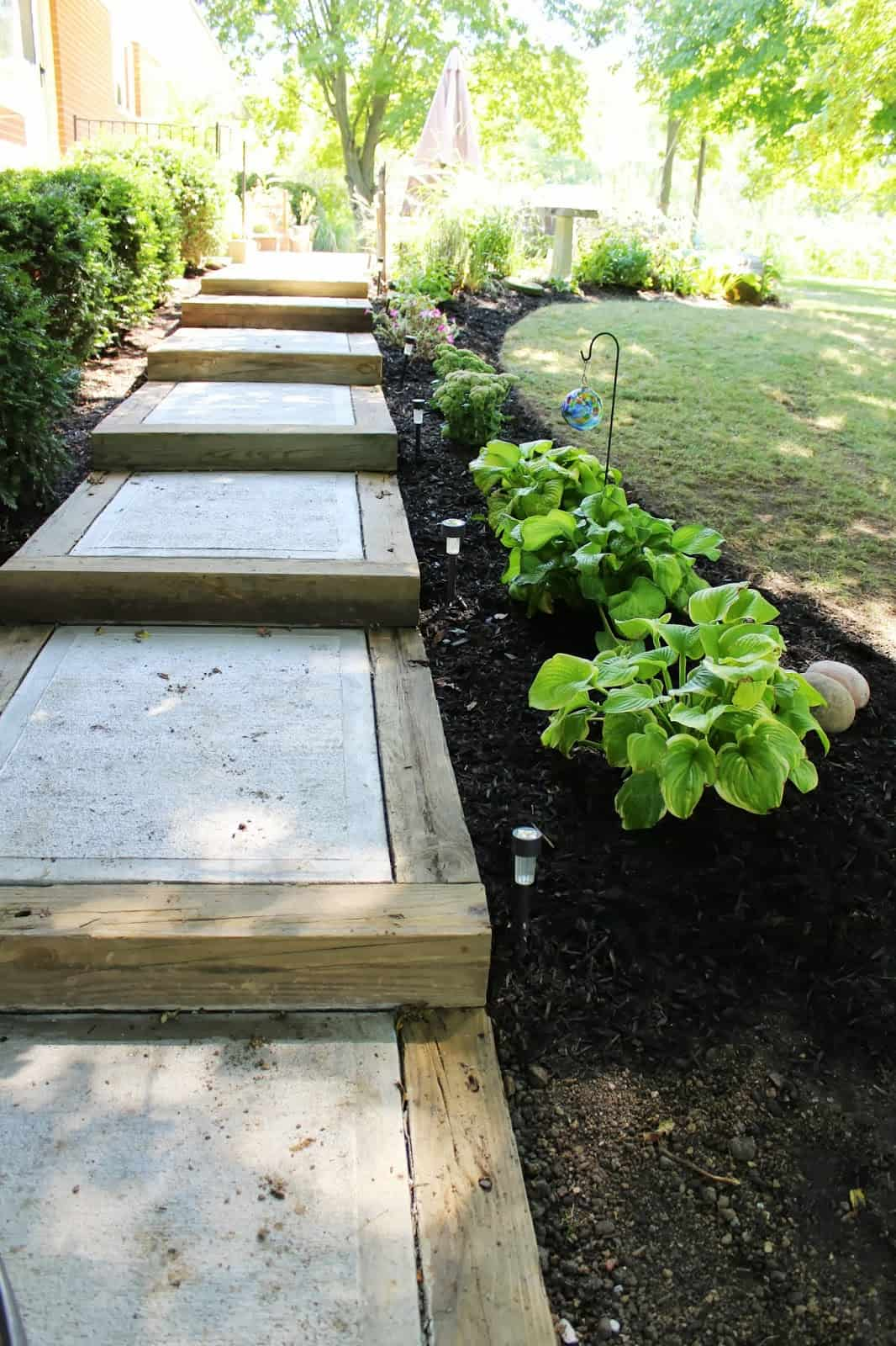 Wood and concrete steps for a garden pathway
